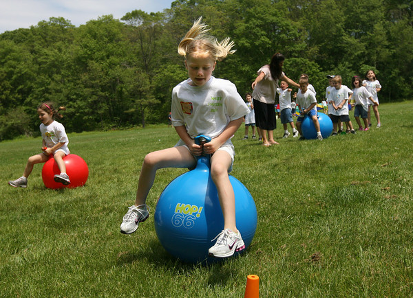 Gloucester: Elle Flemming, a kindergarten student at West Parish Elementary School, participates in a ball hop race during the school's field day yesterday. Photo by Kate Glass/Gloucester Daily Times