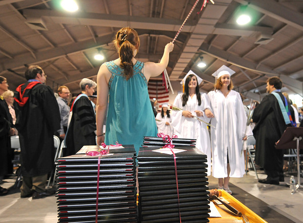 Rockport,  Graduates make their way into the Gymnasium and past their deploma's during the Graduation Ceremony last night at RHS. Desi Smith/Gloucester Daily Times.