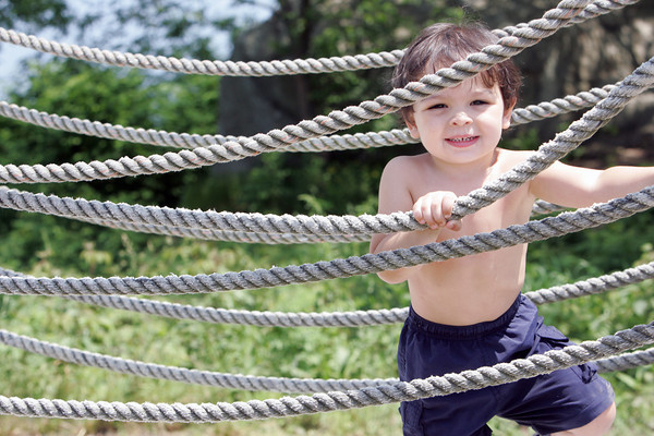 Antonio Dearaujo, 2, of Framingham, climbs along the lighthouse bridge at Stage Fort Park in Gloucester on Wednesday enojying the sun. Photo by Maria Uminski/Gloucester Daily Times
