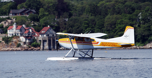 David Le/Gloucester Daily Times. A Cessna 180 water plane piloted by Keith Deschambeault, owner and pilot of Acadian Seaplanes, of Rangeley Maine, prepares to take off from Gloucester Harbor on Friday morning. 7/1/11.