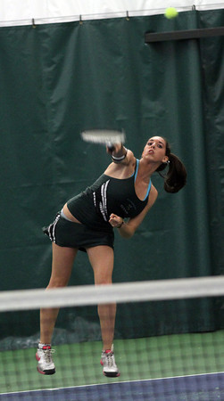 Manchester Essex's Michelle Fuca leaps off her feet to serve as the Hornets play Austin Prep in the Quarter Finals fo the Division 3 North Team Tennis Tournament at the Manchester Athletic Club yesterday. Photo by Kate Glass/Gloucester Daily Times