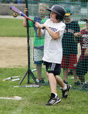 David Le/Gloucester Daily Times. Matthew Connolly, 9, of Rockport, makes contact but fouls a ball away during the Viking Baseball Camp on Tuesday afternoon. 6/28/11.