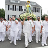 David Le/Gloucester Times. The statue of St. Peter, carried by members of St. Peter's Fiesta Committee, turns a corner and heads towards St. Ann's Church on Sunday afternoon. 6/25/11.