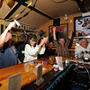 Gloucester:  Rick and Nina Oliver react when the Bruins scored in the 1st period last night at Espresso's Playoff Party.  Desi Smith/Gloucester Daily Times. June 12,2011