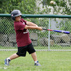 David Le/Gloucester Daily Times. Michael Wonson, 8, of Rockport, pops a ball up during a scrimmage at the Viking Baseball Camp on Tuesday afternoon.  6/28/11.
