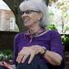 David Le/Gloucester Daily Times. Penny Adams, of Manchester, smiles while listening to a poem during Poetry n' Picnic, where people were invited to come write poetry and enjoy some picnic snacks on the front lawn of Manchester Public Library. 6/27/11.