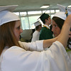 Corey Bradley adjusts Brittany Edwards' graduation cap before heading to the Manchester Essex Regional High School graduation ceremony yesterday evening. Photo by Kate Glass/Gloucester Daily Times