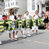 David Le/Gloucester Times. From left, Zach Abbott, Monique Palmisano, Marcus Martin, Wylynn Palmisano, and Taylor Abbott, carry a St. Peter's wreath past the American Veterans Post 32 house on Prospect St. on Sunday afternoon. 6/25/11.