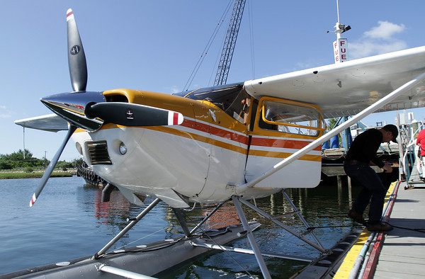David Le/Gloucester Daily Times. A Cessna 180 water plane piloted by Keith Deschambeault, owner and pilot of Acadian Seaplanes, of Rangeley Maine, sits at the dock of Cape Ann Marina after some adjustments were made so the plane could take off from Blynman Canal on Friday morning. 7/1/11.