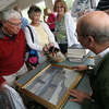 Essex: Michael March of Blackwood March Auctioneers talks to Len and Judy deCoste about an Emile Gruppe painting they brought to the 3rd Annual Antique Appraisal Night at Periwinkles Restaurant last night. Judy's mother had received the painting as a wedding present from a dentist who accepted the painting from Gruppe in exchange for dental work. Photo by Kate Glass/Gloucester Daily Times