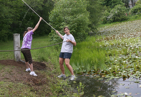Manchester Essex Superintendent Pamela Beaudoin tries crossing the pond behind Essex Elementary School during their last day of school. The fifth grade students all attempt to cross as well as first year teachers. Photo by Kate Glass/Gloucester Daily Times