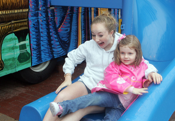 Olivia Zarzoun and Marley Nelson, 4, of Melrose slide down the blue slide at the end of the Magic Maze at the Fiesta Carnival on Wednesday. Photo by Maria Uminski/Gloucester Daily Times