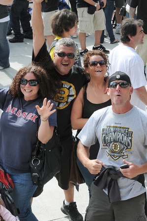 Boston: Long time Bruins fan Sam (Sammo) Frontiero of Gloucester center celebrates his birthday with daughters Samantha left and Monique right and Mike Stevens at the Bruins Victory parade held Saturday in Boston. Desi Smith/Gloucester Daily Times. June 18,2011.