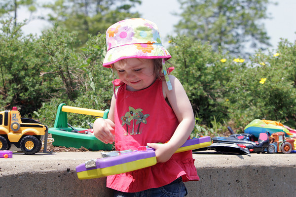 Scarlet Richardson Ellement, 2, of Milton plays with a purple toy guitar at Stage Fort Park in Gloucester. Photo by Maria Uminski/Gloucester Daily Times