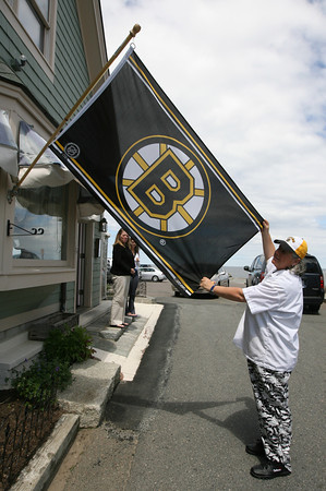 Kathy Milbury, owner of My Place by the Sea, shows off the Bruins flag she has in front of the restaurant during the Bruins quest for the Stanley Cup. Her brother, Mike Milbury, was the head coach of the Boston Bruins the last time they played for the cup. Photo by Kate Glass/Gloucester Daily Times
