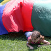 Lauren Alves of Ms. Bruni's 3rd grade class tires to fight off an attack during a parachute game of shark at the Rockport Elementary School field day. Photo by Maria Uminski/Gloucester Daily Times