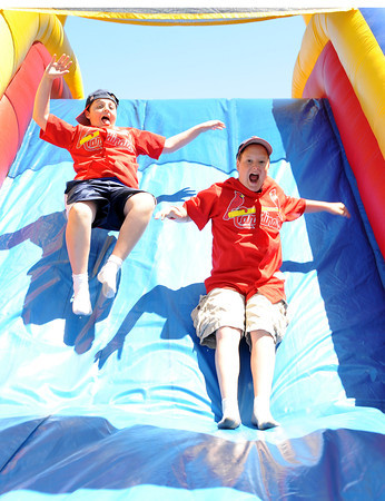 Gloucester:  Cardinals teammates Joseph Verga 12, and Ryan Stregcino 12, enjoy their day by going down the air slide Saturday morning at the Little Leauge Home Run Durby at Boudreau Field.   Desi Smith/Gloucester Daily Times.