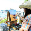 David Le/Gloucester Daily Times. Tarryl Gabel, of Hyde Park, NY, sits across from Bearskin Neck and paints on a warm Wednesday afternoon. 6/29/11.