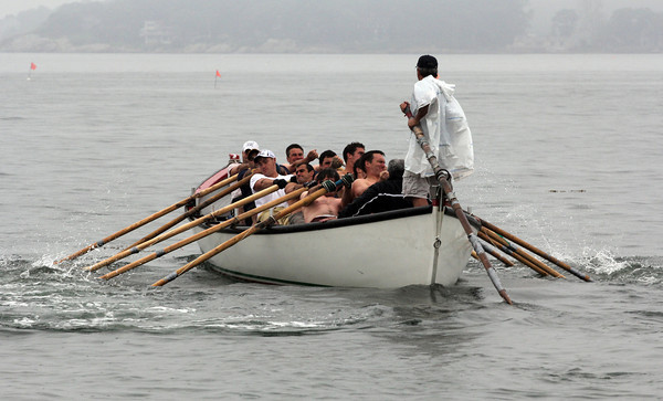 "The ""Seize the Moment"" crew heads out from Pavilion Beach during the seine boat elimination races yesterday. The team will be competing in the finals on Sunday. Photo by Kate Glass/Gloucester Daily Times"
