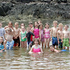 Noah Willette and his classmates from the Plum Cove School enjoy the warm weather on Thurday by spending some time at Plum Cove Beach. Photo by Maria Uminski/Gloucester Daily Times