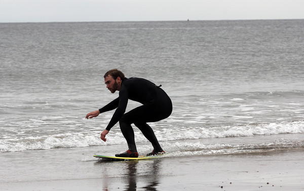 Ben Ryan of Rockport skimboards at Cape Hedge Beach with his friend, Nat Jacques (not shown) yesterday afternoon. Photo by Kate Glass/Gloucester Daily Times