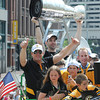 Boston: Zdeno Chara holds up the Stanley Cup to thousands of fans during the Bruins Victory parade held Saturday in Boston, as ________gives the thumbs up. Desi Smith/Gloucester Daily Times. June 18,2011.