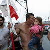 David Le/Gloucester Times. Friday evening's Greasy Pole winner, Joe Da Silva, kisses his niece Arianna Pacheco, 3, while clutching the pole he had won minutes earlier. 6/24/11.