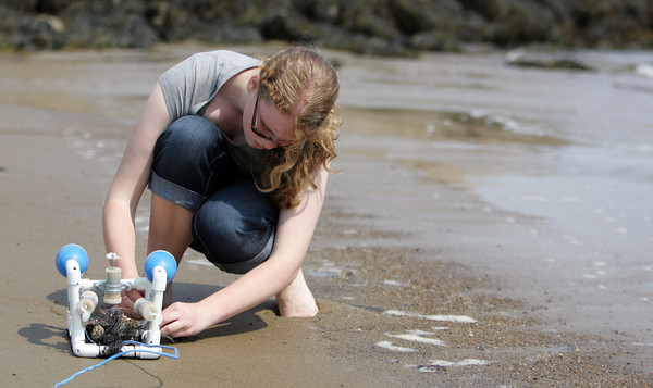 Emily Dailey of Rockport Middle School puts the finishing touches on her Submersible ROV before sending it off into the waters of Front Beach. She made the ROV at the Maritime Heritage Center over April vacation. The students are using the ROVs to track American Eel migration. Photo by Maria Uminski/Gloucester Daily Times