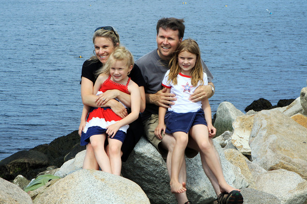 David Le/Gloucester Daily Times. Clockwise from back left, Lori, Edward, Brooke, 8, and Shannon Kearney, 6, of Minnesota, have their picture take on the rocks near Bearskin Neck while on a visit to Rockport. 6/28/11.