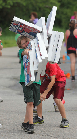 Kyle Muise tries to walk with 11 pizza boxes during a race at West Parish Elementary School's Field Day on Friday. Photo by Kate Glass/Gloucester Daily Times