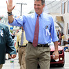 David Le/Gloucester Times. Massachusetts State Senator Scott Brown waves to spectators during the Fiesta Parade on Sunday morning. 6/25/11.