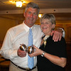 Steve Rowell and his wife, Linda, both longtime Rockport educators, hold up pewter apples they received as gifts during their retirement party  at the Elks Club in Gloucester on Thursday night. Photo by Kate Glass/Gloucester Daily Times