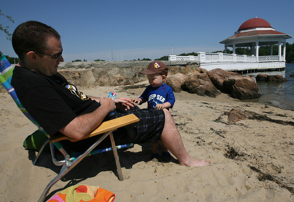 Jeff Miller of Manchester and his son, Rylie, 2, soak in the sun and scenery at Tuck's Point. Photo by Kate Glass/Gloucester Daily Times