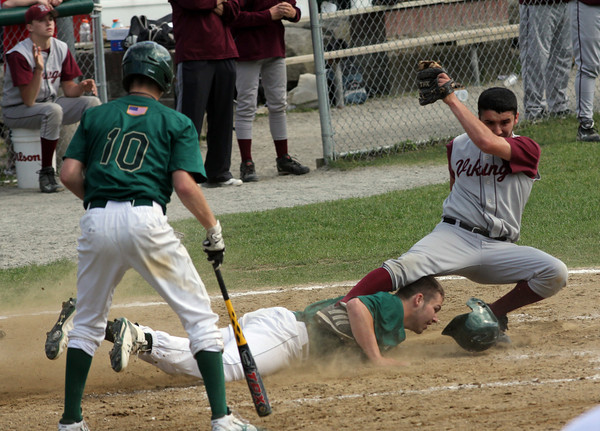 Rockport: Matignon third baseman Tom Kervick slides under Rockport pitcher Rob Nelson during the first round of the MIAA Division 4 North baseball championship at Evans Field yesterday. Matignon won the game 4-2. Photo by Kate Glass/Gloucester Daily Times