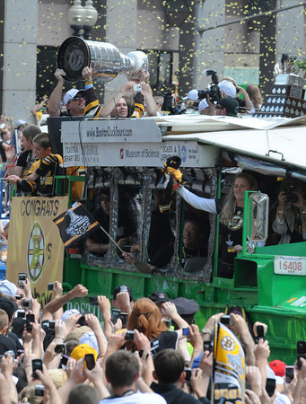 Boston: The Stanley Cup is hoisted up during the start of the victory parade celebration Saturday June 18,2011 starting at the TD Garden. Desi Smith/Gloucester DailyTimes.