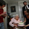 "Gloucester: Laura Higgins presents a birthday cake to her grandmother, Irma Sullivan, as Velma Higgins, left, and Thomas Riley, President of Seniorlink, look on yesterday afternoon. Irma recently turned 100 and Seniorlink, which provides care to the elderly in their own homes, wanted to meet and celebrate their oldest client. Irma says she doesn't have any secrets to longevity. According to her, she ""just got old."" Photo by Kate Glass/Gloucester Daily Times"
