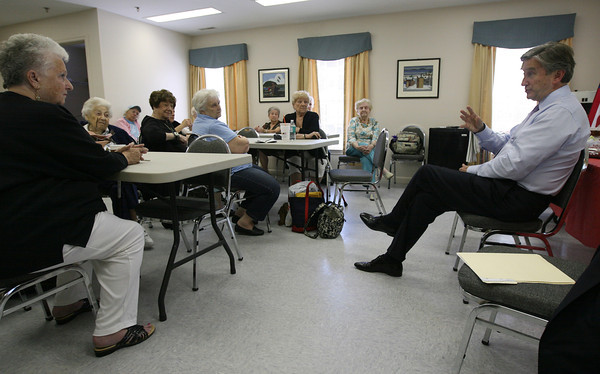 Congressman John Tierney speaks with seniors about their Medicare concerns at the Essex Senior Center yesterday afternoon. Photo by Kate Glass/Gloucester Daily Times