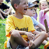 "David Le/Gloucester Daily Times. Daniel Merc, 7, of Rockport, breaks out laughing at a joke told by ""Awesome"" Robb Preskins, also known as Captain Robbie Bones, during his Sky Pirate Show at Millbrook Meadow Park in Rockport on Wednesday afternoon. 6/29/11."