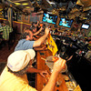 Gloucester: Fans cheer and use their noise makers as the Bruins take the ice last night at Espresso's Playoff Party.  Desi Smith/Gloucester Daily Times. June 12,2011