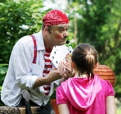 "David Le/Gloucester Daily Times. ""Awesome"" Robb Preskins posed as Captain Robbie Bones for his Sky Pirate Show at Millbrook Meadow Park in Rockport on Wednesday afternoon and waits for Molly Timmons, 8, of Rockport, to choose a card as part of his performance. 6/29/11."
