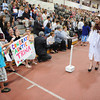 Gloucester:Michael Francis 6, and Anna Maria Scuderi 6, hold up a sign they made for their Aunt Caterian Scuderi as shepasses by after getting her diploma, Sunday afternoon at Graduation held inside at the Benjamin A. Smith Fieldhouse.   Desi Smith/Gloucester Daily Times. June 12,2011