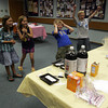 From Left to Right, Lila Olsen,9, Mila Barry 8, Emma Christopher 8, Andrew Topouzoglou, 9 and Justin McNiff, 10, all jump at the sight of a acid-base reaction at the Gloucester Library during a chemistry club event. Photo by Maria Uminski/Gloucester Daily Times