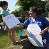 "Margaret Acampora adjusts the sign on her granddaughter, Gina Evangelista, 4, which reads, ""Save My Nana's Hospital"" as nurses picket outside Addison Gilbert Hospital yesterday. Photo by Kate Glass/Gloucester Daily Times"