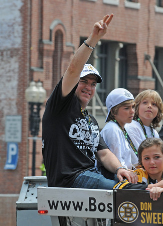 Boston Bruin's Mark Recchi waves to the crowd during a parade honoring NHL hockey's Stanley Cup Champions Saturday, June 18, 2011 in Boston. Recchi, who was the oldest active player in the NHL at 43, announced his retirement shortly after winning the Stanley Cup.Desi Smith/Gloucester Daily Times.