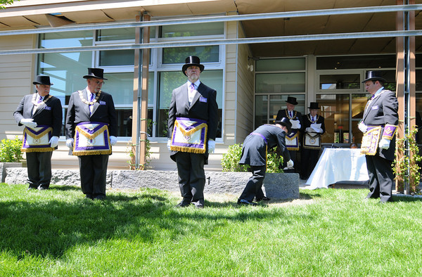 Gloucester: Deputy Grand Master George J Bibilos (right) watches over David E Pace as he uses a level to check the connor stone, as Mason members from left to right Thomas Stark,Wayne M Vinton and Mason Russell wait to do their part at the Temple Ahavat Achim for cornerstone ceremony Sunday afternoon.   Desi Smith/Gloucester Daily Times.
