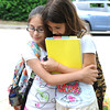 Rockport:  Friends Andraya Ortiz 11, and Euamaria Rudler 11, give each other a hug on the last day of school Friday afternoon at Rockport Elementary School. Desi Smith/Gloucester Daily Times. June 17,2011