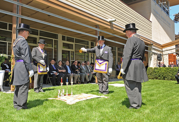 Gloucester: Mason Russel pours out some corn from a goblet as from left to right Thomas Stark,David E Pace and Wayne M Vinton were part of the ceremony at the Temple Ahavat Achim for cornerstone ceremony Sunday afternoon.   Desi Smith/Gloucester Daily Times.