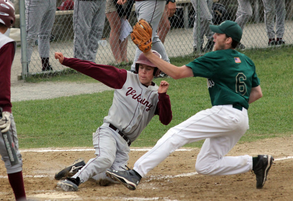 Rockport: Rockport's Jay Fulmer slides under the tag of Matignon pitcher Matt Levasbury for the first run of the game during the first round of the MIAA Division 4 North baseball championship at Evans Field yesterday. Matignon won the game 4-2. Photo by Kate Glass/Gloucester Daily Times
