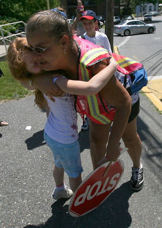 Nancy Townsend, the crossing guard at Veterans Memorial Elementary School, hugs Shannon Connolly, who will be going into 2nd grade next year, before heading home from the last day of school yesterday. Photo by Kate Glass/Gloucester Daily Times