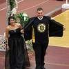 Racquel Shaw laughs as her date, Scott Anderson, opens his tuxedo to reveal a Boston Bruins jersey during the Gloucester High School Promenade last night. The crowd gathered at the fieldhouse erupted in cheers. Photo by Kate Glass/Gloucester Daily Times